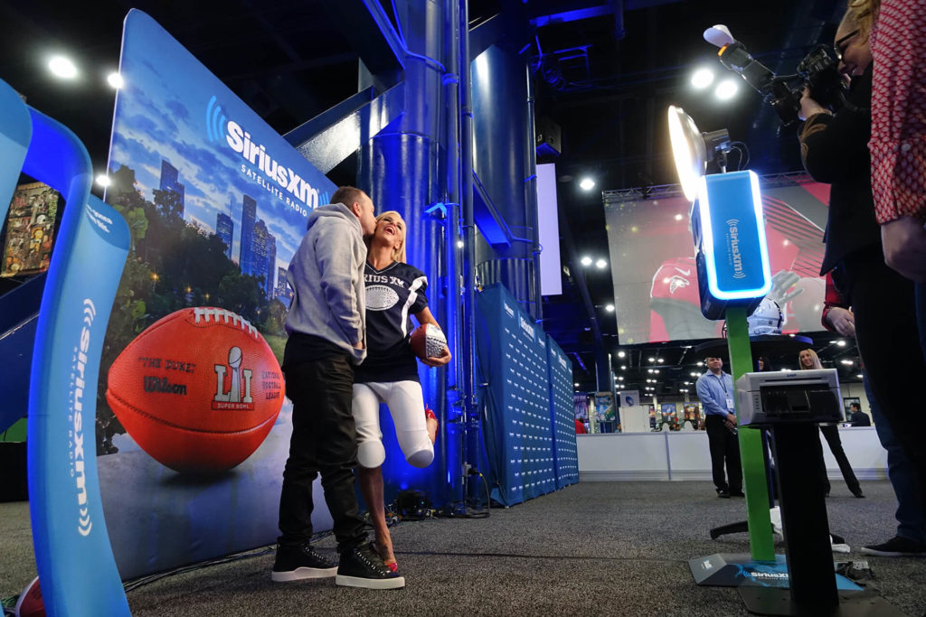 Donny Whalberg and Jenny McCarthy inside SiriusXM Super Bowl Photo Booth