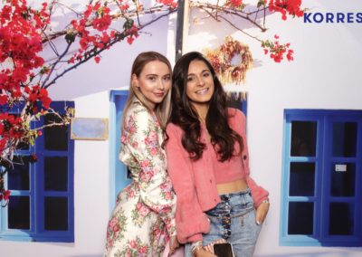 Beauty Influencers and bloggers pose for photo at the korres photo booth