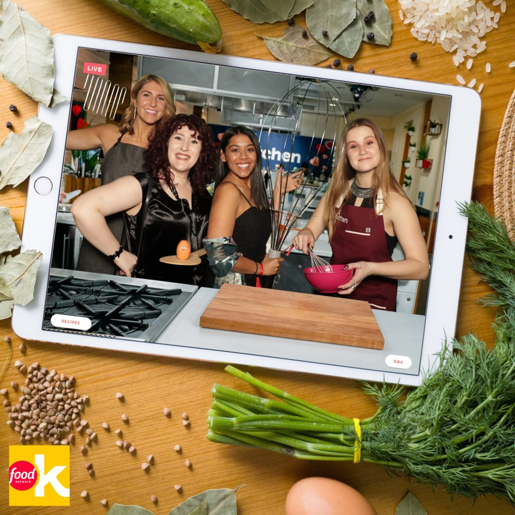 Four girls posing in food network kitchen photo booth green screen