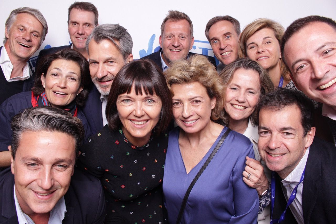 large group of staff in photo booth