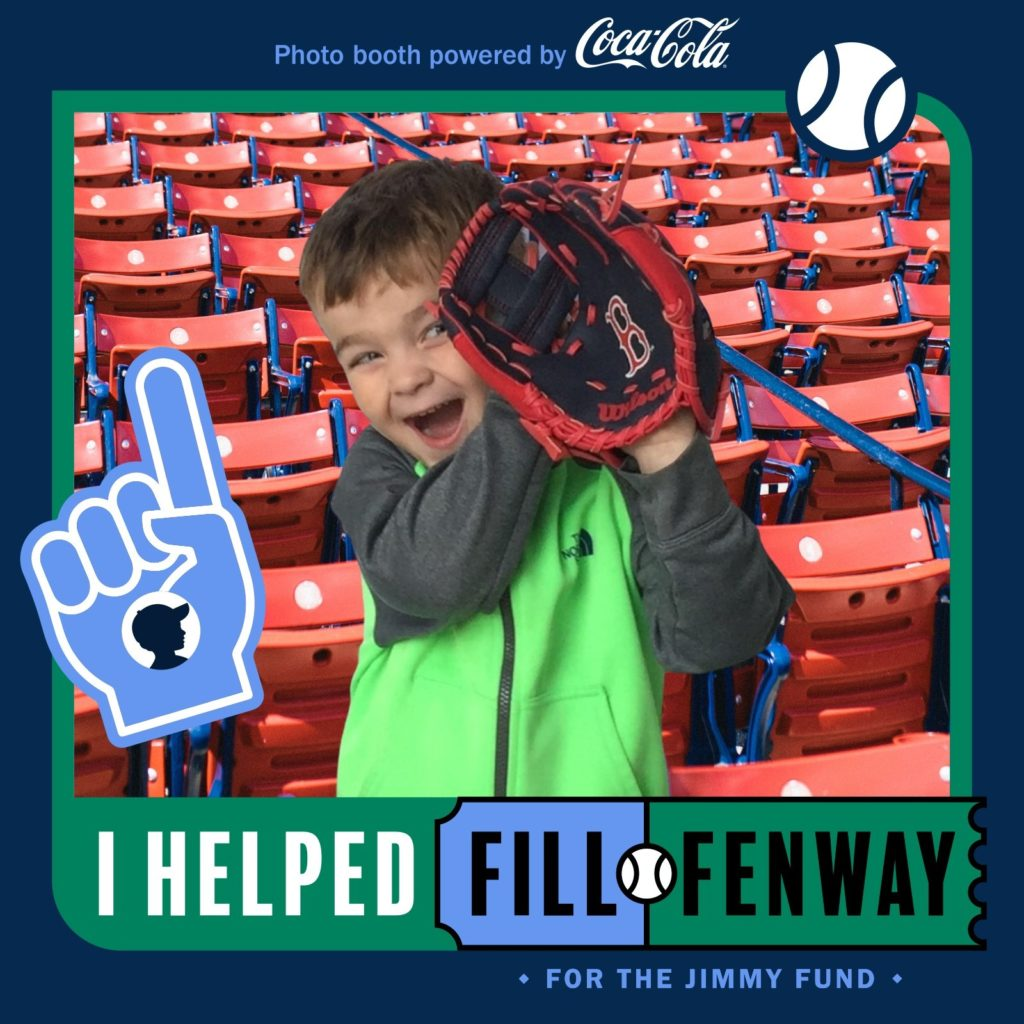 Child with baseball glove at fenway park