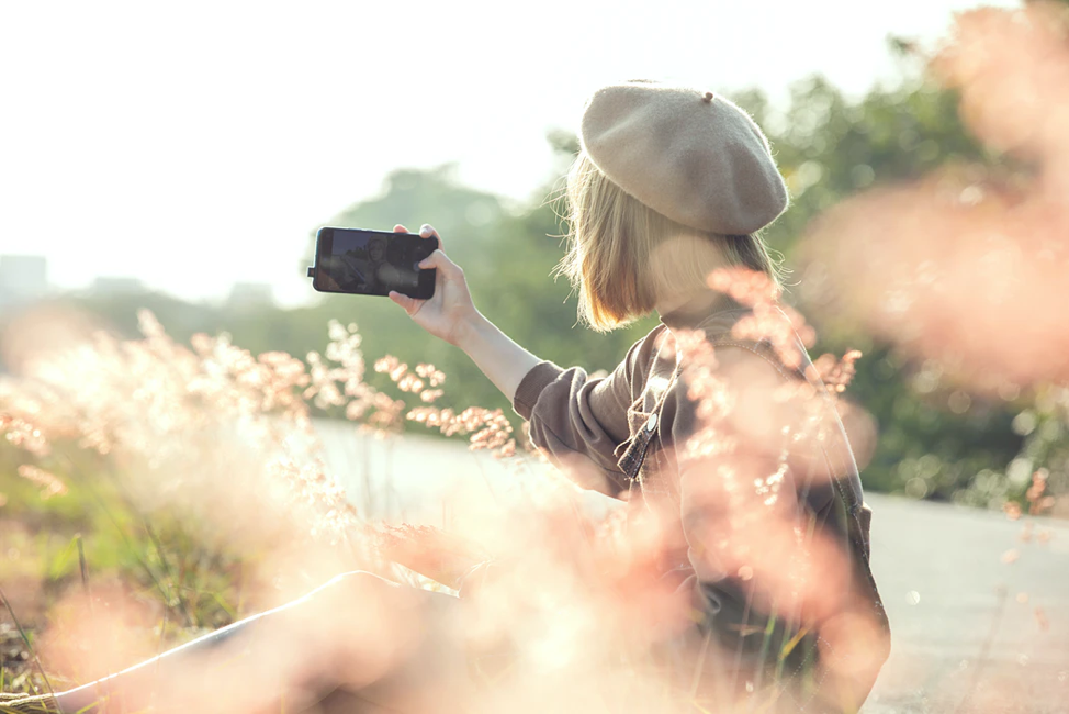 girl takes a selfie in a field